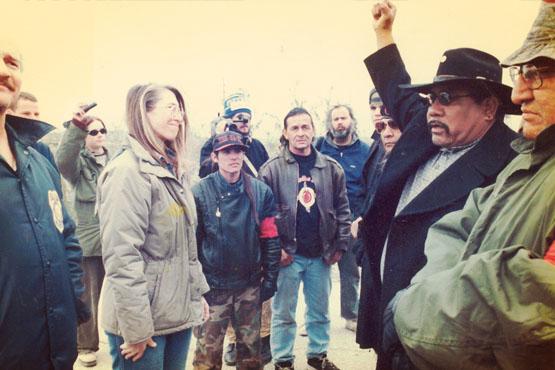 BLM officials (far left) sent to evict activists. Wally Antone (Quechan), right; AIM member (far right), Feburary 13, 1998. Photo: Greenaction.